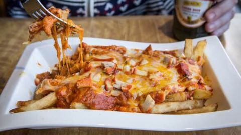 The butter chicken poutine at Toronto's Nawab Fusion Grill combines Canadian and Indian comfort foods.