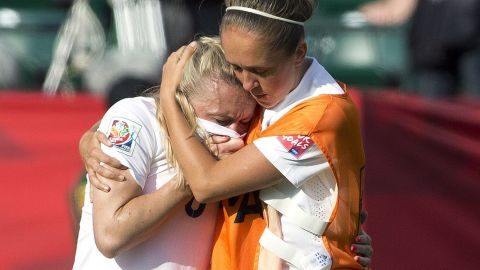 England's Josanne Potter, right, consoles Bassett after the whistle.