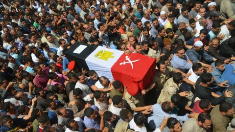 """People in Ashmoun, Egypt, carry the coffin for 1st Lt. Mohammed Ashraf, who was killed when the ISIS militant group <a href=""""http://www.cnn.com/2015/07/02/world/isis-egypt-expanding-reach/index.html"""" target=""""_blank"""">attacked Egyptian military checkpoints</a> on Wednesday, July 1. At least 17 soldiers were reportedly killed, and 30 were injured."""