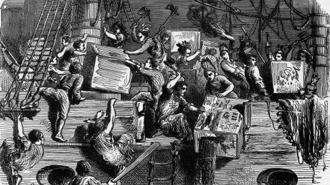 """Enraged by the British Parliament's tax on tea, rebel colonists, some disguised as Native Americans, destroyed an entire East India Company tea shipment in the Boston Harbor. The British government responded with a crackdown on self-government in the colonies, which liberty-seeking colonists called the """"Intolerable Act."""" Rising tensions sparked the American Revolution in 1775."""