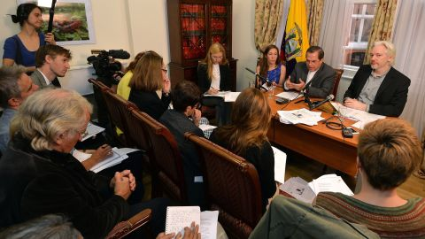 WikiLeaks founder Julian Assange, far right, and Ecuador's Foreign Minister Ricardo Patino sitting next to him, attend a press conference inside the Ecuadorian Embassy in London, England on August 18, 2014.