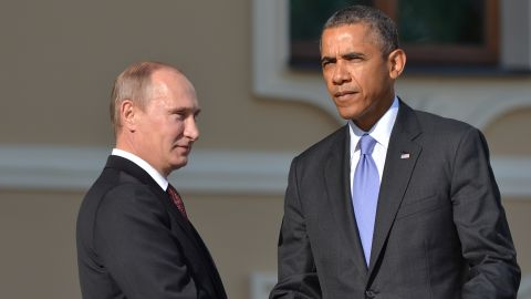 In this handout image provided by Host Photo Agency, Russian President Vladimir Putin (L) and U.S. President Barack Obama shake hands during an official welcome during the G20 Summit on September 5, 2013 in St. Petersburg, Russia.