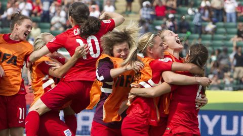 England celebrates a penalty kick goal against Germany during extra time at the Women's World Cup soccer third-place match in Edmonton, Alberta, on Saturday, July 4. England defeated Germany with a final score of 1-0.