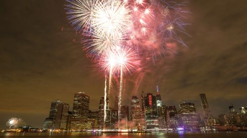 Fireworks illuminate the sky over the East River during the 39th annual Macy's 4th of July fireworks in New York City.