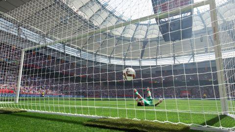 Japan goalkeeper Ayumi Kaihori allows a third goal to United States' Carli Lloyd during the first half.