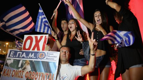 Caption:ATHENS, GREECE - JULY 06: People celebrate in front of the Greek parliament as the people of Greece reject the debt bailout by creditors on July 6, 2015 in Athens, Greece. The greek people have rejected a debt bailout in a referendum with nearly 62% voting 'No', against 38% voting 'Yes' according to interior ministry figures (Photo by Christopher Furlong/Getty Images)
