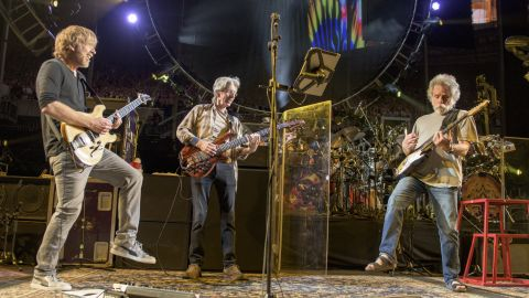"""Phish guitarist Trey Anastasio, left, plays with Lesh and Weir at the """"Fare Thee Well"""" show in Chicago on Saturday, July 4."""