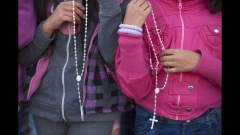 Catholics wait outside the Apostolic Nunciature in Quito on July 6.
