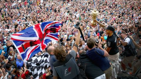 Formula One driver Lewis Hamilton holds up his trophy after winning the British Grand Prix on Sunday, July 5. It's already the fifth win of the season for Hamilton, a British driver who was last season's world champion.