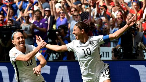 Lloyd, right, celebrates with teammate Lauren Holiday after scoring her second goal of the World Cup final.