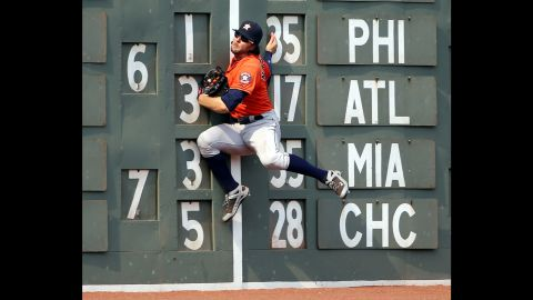 Houston outfielder Jake Marisnick crashes into the wall while making a catch Sunday, July 5, in Boston.