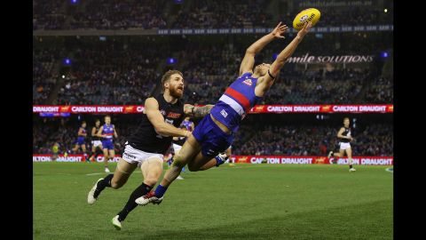 Luke Dahlhaus of the Western Bulldogs grabs the ball Saturday, July 4, during an Australian Football League match against the Carlton Blues in Melbourne.