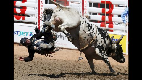 Chad Besplug is tossed off the bull Teen Spirit on Friday, July 3, during the Calgary Stampede in Calgary, Alberta.