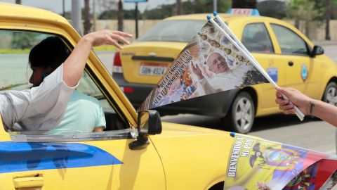 A street vendor sells commemorative flags at the entrance of Samanes Park in Guayaquil, Ecuador, on Sunday, July 5.
