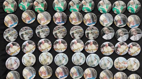Pope buttons are sold at Samanes Park on July 5.