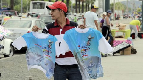 Pope T-shirts are sold in the streets of Guayaquil on July 5.