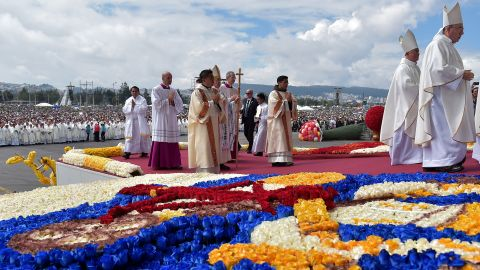 Pope Francis takes the stage for the Mass at Quito's Bicentennial Park on July 7.