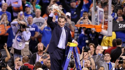 Head coach Mike Krzyzewski of the Duke Blue Devils cuts down the net after defeating the Wisconsin Badgers during the NCAA Men's Final Four National Championship at Lucas Oil Stadium on April 6, 2015 in Indianapolis, Indiana.