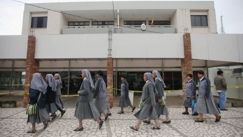 SANTA CRUZ, BOLIVIA - JULY 08: Nuns walk past a shuttered building on a street near the area where Pope Francis will hold Mass on July 8, 2015 in Santa Cruz, Bolivia. Pope Francis will arrive in Santa Cruz July 8 and hold his open-air Mass there July 9 during his three-country swing through Ecuador, Bolivia and Paraguay. (Photo by Mario Tama/Getty Images)