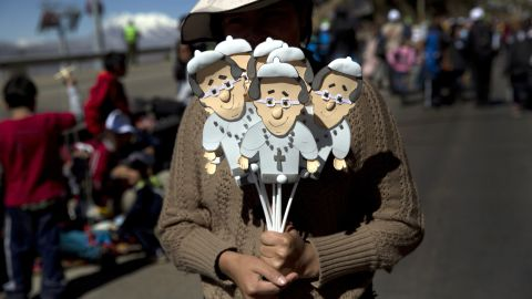 """A street vendor sells cutout images of Pope Francis near the airport in El Alto, Bolivia, on Wednesday, July 8. Memorabilia is being sold across South America to commemorate <a href=""""http://www.cnn.com/2015/07/05/americas/gallery/pope-francis-south-america/index.html"""" target=""""_blank"""">the Pope's eight-day tour</a> of Ecuador, Bolivia and Paraguay."""