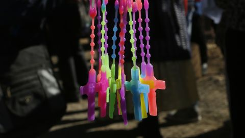 Multicolored crucifixes are sold near the airport in El Alto on July 8.