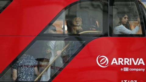 Commuters ride a packed bus. People have been urged to travel outside peak hours.<br />
