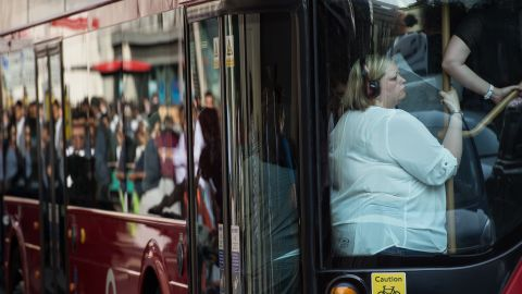 People squeeze onto a bus on July 9.
