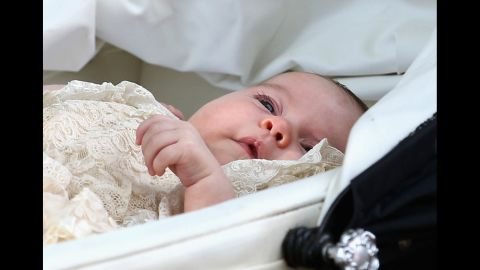 Charlotte is pushed in her pram following her christening.