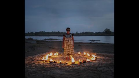 """The fire in this photo represents knowledge of tradition and identity, and the blindfold represents lack of awareness, Sanchez Renero said. """"Women are the ones who transmit identity and traditions,"""" she said. """"There is some blindness with the women -- to not be aware of their own work, their own place, their own history."""""""