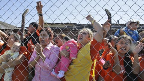 """Female inmates, some holding their babies, shout, """"We want your blessing!"""" as the Pope leaves Palmasola prison on July 10."""