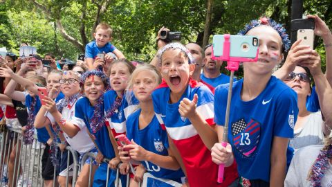 Young fans line the parade route. The cost of the parade is reportedly $2 million.