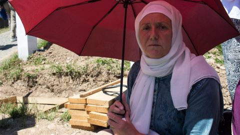 """Hadzira Dozic's brother was 32 when killed in 1995. She sits beside an open grave, waiting for his remains to finally be buried. Her husband and three of his brothers were also killed, along with around 30 other family members. """"It can never be done. How can it be done?"""""""