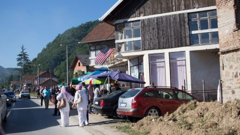 An American flag flies outside a house on the road to Srebrenica. Though NATO intervention and an American-brokered peace brought the Bosnian war to an end, many also blame President Bill Clinton for failing to stop the conflict earlier.