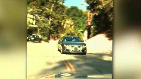 vehicle driving in reverse down busy road california dnt_00012903.jpg