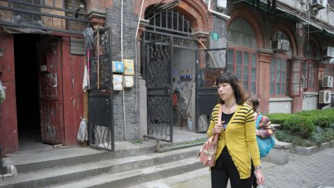 """A woman walks through Shanghai's former Jewish ghetto on May 7, 2013. Today, there are few remnants of its Jewish history although organizations like the <a href=""""http://chrlawyers.hk/en/content/1100-14-july-2015-146-lawyers-law-firm-staffhuman-right-activists-have-been-detainedarrested"""" target=""""_blank"""" target=""""_blank"""">Shanghai Jewish Refugees Museum</a> are trying to change this."""