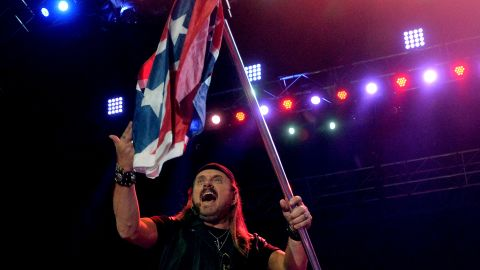 """Lynyrd Skynyrd trotted out the flag as a symbol of rebellion in the 1970s, as seen on <a href=""""https://www.youtube.com/watch?v=ZVT-K82aoVI"""" target=""""_blank"""" target=""""_blank"""">a clip of the band performing """"Sweet Home Alabama"""" in 1975</a>. The group's Gary Rossington<a href=""""http://newsroom.blogs.cnn.com/2012/09/09/lynyrd-skynyrd-talks-southern-roots/""""> told CNN in 2012</a> that it would stop using it, though <a href=""""http://theboot.com/lynyrd-skynyrd-confederate-flag/"""" target=""""_blank"""" target=""""_blank"""">Skynyrd soon brought it back</a>. But now <a href=""""http://www.nola.com/music/index.ssf/2015/06/even_lynyrd_skynyrd_wanted_to.html"""" target=""""_blank"""" target=""""_blank"""">they give American flags more prominence</a>."""