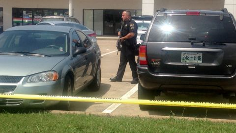 An officer patrols the parking lot of the recruitment center.