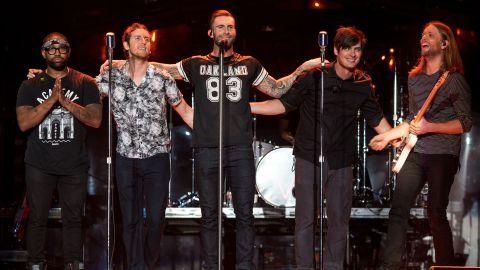 Michael Madden, PJ Morton, Adam Levine, James Valentine, Jesse Carmichael, and Matt Flynn of Maroon 5 perform at The Forum on April 4, 2015 in Inglewood, California.
