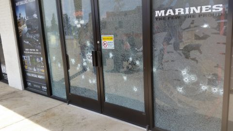 The entrance to the military recruiting office is seen riddled with bullet holes on July 16.