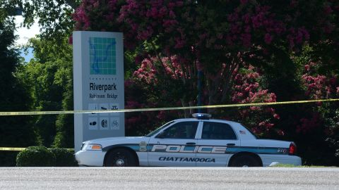 A police car blocks the entrances to the Tennessee Naval Reserve Center on Thursday July 16 in Chattanooga, Tennessee. Authorities say Mohammod Youssuf Abdulazeez, 24, opened fire first on a military recruiting station at a strip mall and then moved to an operational support center operated by the U.S. Navy seven miles away, where he killed four U.S. Marines.   The gunman was also killed.