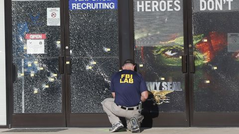 An FBI investigator works outside a military recruiting center where a gunman opened fire Thursday, July 16, in Chattanooga, Tennessee. Authorities say Mohammad Youssuf Abdulazeez, 24, opened fire first on the recruiting station and then moved to a U.S. Navy facility seven miles away. At the Navy facility, he fatally shot four U.S. Marines and wounded three other people before he died in police gunfire. A U.S. Navy sailor later died from his wounds.