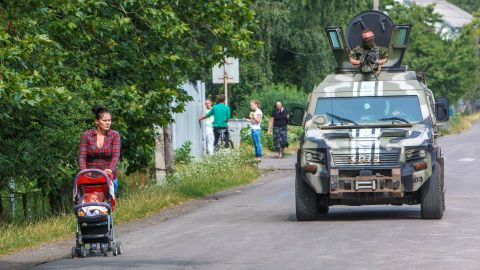 Ukrainian security forces patrol in the village of Bobrovyshche on July 14, 2015.