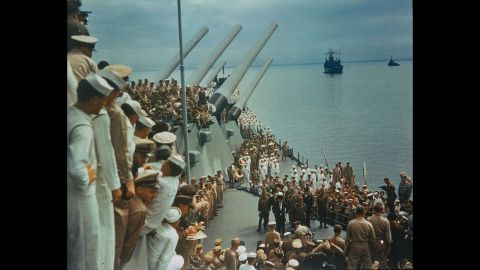Soldiers and sailors on the USS Missouri watch as Japan's formal surrender is signed in Tokyo Bay on September 2, 1945.