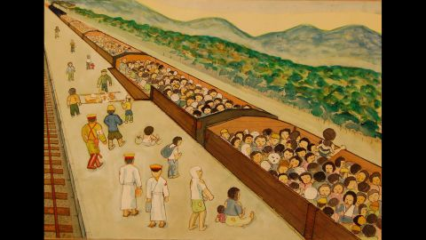 """Like cattle, injured survivors were loaded into rail cars to escape the ruined city. """"Most people were injured, and those with burns were slathered with white medicine,"""" Kazuo Koya said. """"There were so many bandaged people. With only the clothes on their backs, they waited under the blazing sun for departure."""""""
