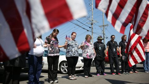 CHATTANOOGA, TN - JULY 17: Miller-Motte Technical College students and others join in prayer across the highway from the strip mall where a gunman attacked the Armed Forces Career Center/National Guard Recruitment Office on July 17, 2015 in Chattanooga, Tennessee. According to reports, Mohammod Youssuf Abdulazeez, 24, opened fire on the military recruiting station at the strip mall on July 16th and then drove to an operational support center operated by the U.S. Navy more than seven miles away and killed four United States Marines there. (Photo by Joe Raedle/Getty Images)