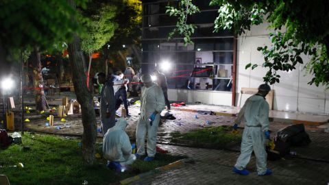 Forensic teams and police officers work at the site of a bomb attack on Monday, July 20, in Suruc, Turkey.