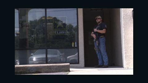 armed civilian stands guard georgia_00000407.jpg