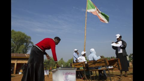 A woman casts her ballot at a polling station in Buye on July 21.