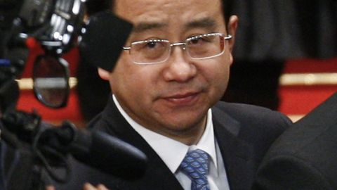 In this 2012, file photo, Ling Jihua, a loyal aide and confidante to President Hu Jintao looks on as he attends the closing ceremony of the National People's Congress at the Great Hall of the People in Beijing.