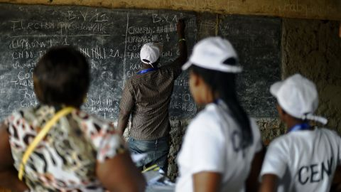 Election officials count votes at a polling station in Bujumbura on July 21.